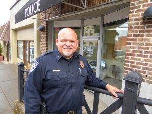 Chief Holste stands outside the basement entry into the existing police facility