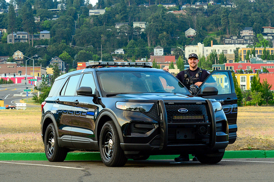 fficer Gabe Wilson with the first of two Hybrid Ford Interceptors